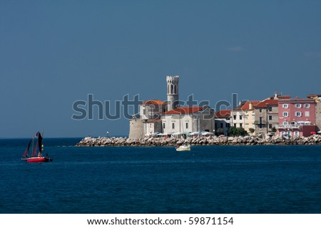 View of beautiful Slovenian city: Piran with ship