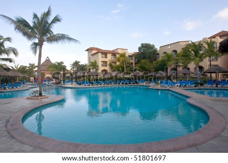 View of beautiful tropical resort patio and pool