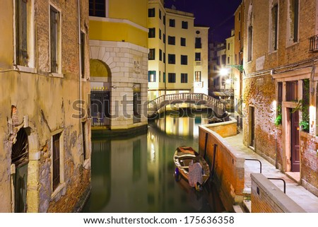 View of beautiful Venetian canal at night, Venice, Italy