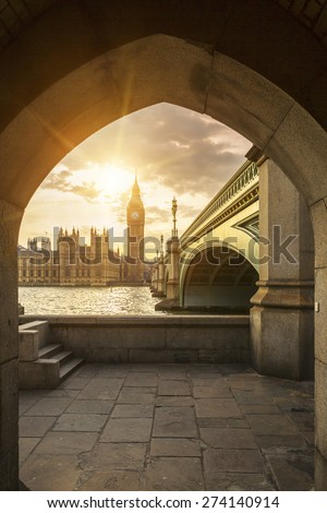 View of Big Ben through the pedestrian tunnel at sunset, London. - stock photo