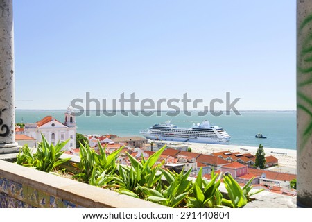 View of big passenger ship in Lisbon port from Alfama Miradouro - stock photo