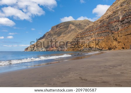 View of black sand volcanic Antequera Beach and big rocks in Tenerife, Canary Islands, Spain