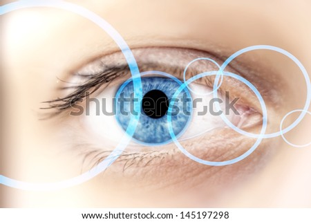 View of blue rings in a beautifull blue woman eye, technology concept - stock photo