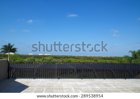 View of Bonita Springs Florida from a large empty roof deck. - stock photo