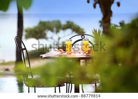 View of breakfast table in resort restaurant - stock photo