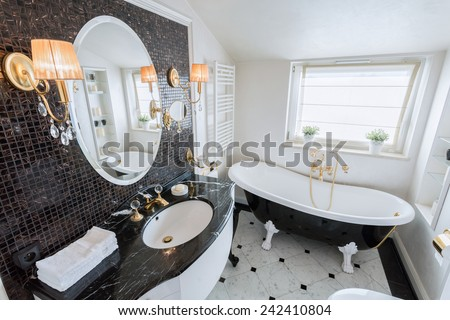 View of bright bathroom in baroque style - stock photo