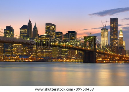 View of Brooklyn Bridge and Downtown Manhattan from across the East RIver. - stock photo