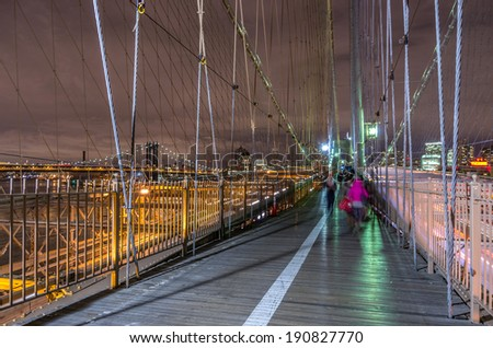 View of Brooklyn Bridge and Manhattan skyline by night - stock photo