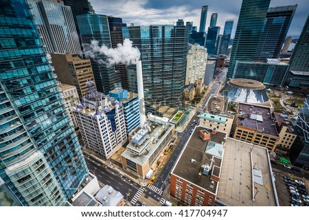 View of buildings along Simcoe Street, in downtown Toronto, Ontario.