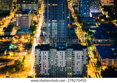 View of buildings and streets in downtown Seattle at night, in Seattle, Washington. - stock photo