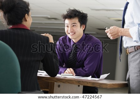 View of business executives having conversation.
