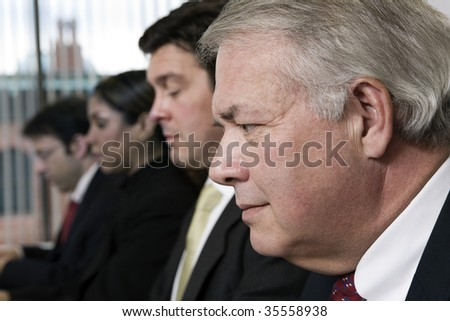 View of  business people working in an office. - stock photo