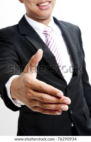View of businessman extending hand to shake - stock photo