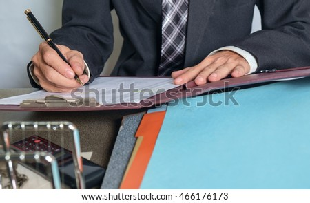 View of businessman working in the office.
