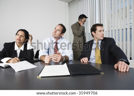 View of businesspeople thinking in an office. - stock photo