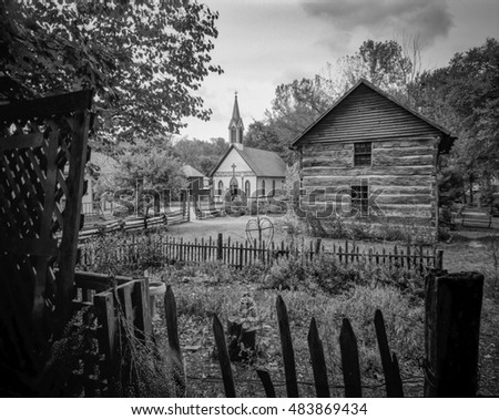 View of Cabin and Church from Garden Billie Creek park in Indiana
