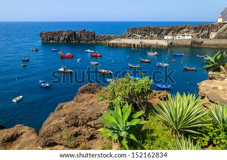 View of Camara de Lobos bay and many colorful fishing boats in south of Madeira island, Portugal - stock photo