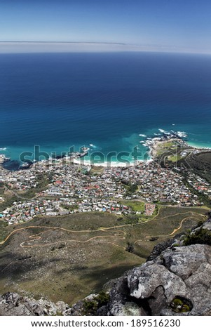 View of Camps Bay, a suburb of Cape Town, South Africa. Shot taken from the top of Table Mountain. - stock photo