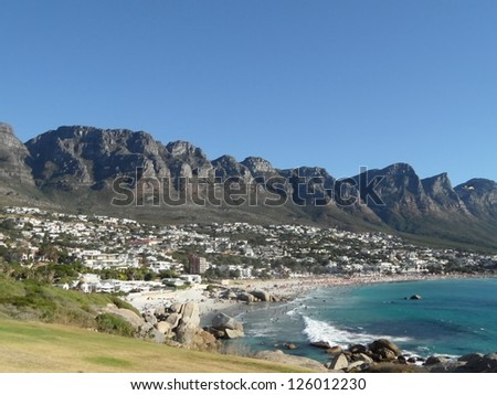 view of Camps bay and the twelve apostles - stock photo