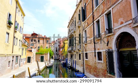 View of canal and boats with ancient architecture in Venice, Italy - stock photo