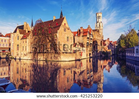 View of canal, tower Belfort and houses in medieval fairytale town Bruges at morning, Belgium - stock photo