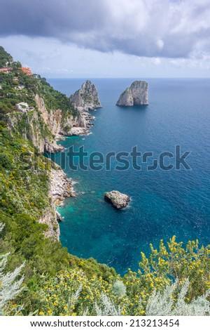 View of Capri Island coast and Faraglioni from Giardini di Augusto - stock photo