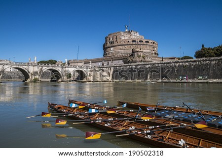 View of Castel Sant'Angelo and the canoes in the foreground from the Tiber in Rome, Italy - stock photo