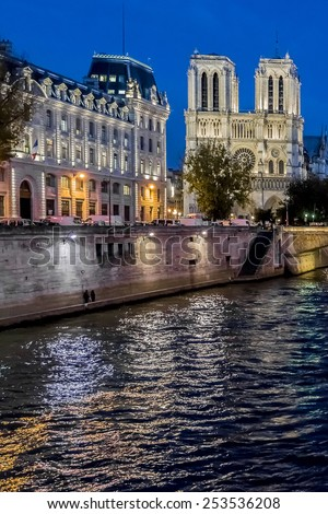 View of Cathedral Notre Dame de Paris at night - a most famous Gothic, Roman Catholic cathedral (1163 - 1345) on the eastern half of the Cite Island. - stock photo
