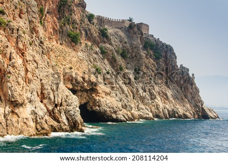View of cave in the rock and the ancient fortress. Alanya.Turkey. Mediterranean sea. - stock photo