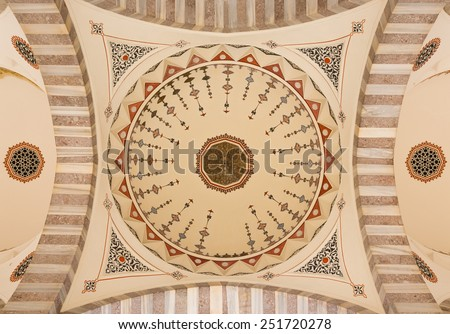 View of ceiling and decorations of mosques dome in Istanbul - stock photo