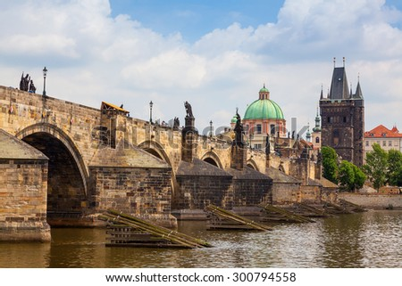 View of Charles Bridge in Prague showing the tower and St Francis church