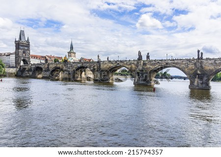 View of Charles Bridge (Karluv most, 1357), a famous historic bridge that crosses the Vltava River in Prague, Czech Republic. Bridge is decorated by 30 statues, originally erected around 1700.