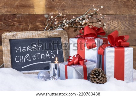 View of Christmas gifts with candles. - stock photo