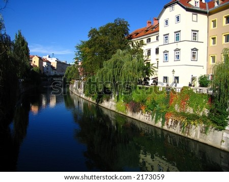 View of city life around the river flowing through Ljubljana, Slovenia.