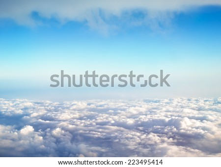 view of clouds and blue sky from high mountain