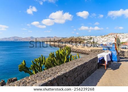 View of coast from promenade on Lanzarote island in Puerto del Carmen town, Spain - stock photo