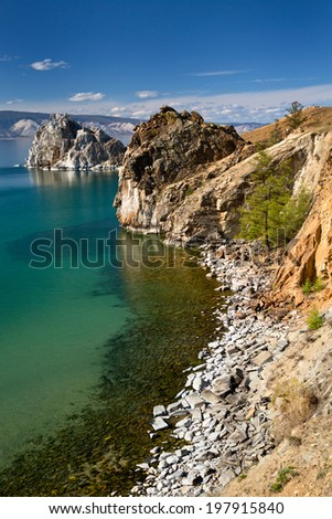View of coast of Baikal lake, Shaman rock and cape Burhan on Olkhon Island, Russia  - stock photo