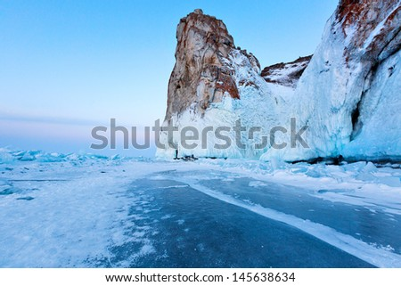 view of coast of Olkhon island and frozen baikal lake in winter  - stock photo