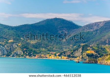 view of coastline of cinque terre national park with monterosso al mare village at the very end in italy.