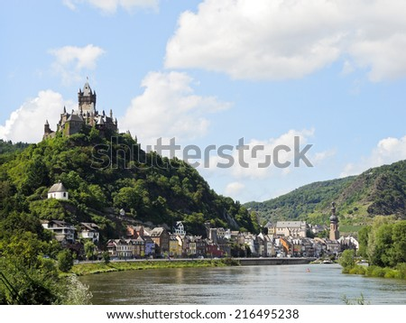 view of Cochem on Moselle river and Cochem Imperial castle over town in Germany - stock photo