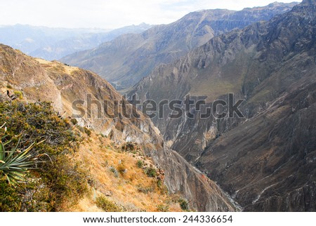 View of Colca Canyon, Peru, South America from Mirador Cruz del Condor. One of the deepest canyons in the world. - stock photo