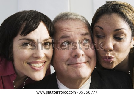 View of colleagues together and smiling. - stock photo