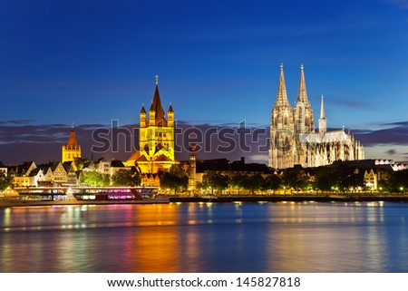 view of Cologne Cathedral and Great St. Martin Church, Germany - stock photo