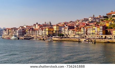 View of colorful buildings in Porto riverside and Douro river in Portugal.