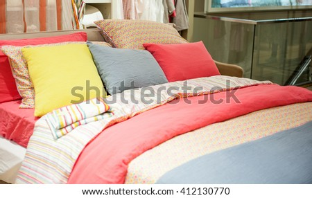 View of colorful pillows on bedroom