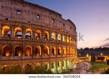 view of Colosseum illuminated at night  in Rome, Italy - stock photo