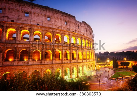 view of Colosseum illuminated at night  in Rome, Italy, toned - stock photo