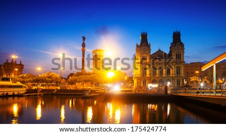 view of Columbus Quay from Port Vell in evening. Barcelona, Catalonia - stock photo