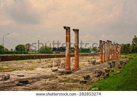 View of columns, Roman ruins on Archeological area of Aquileia in Italy - stock photo