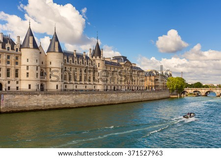 View of Conciergerie - former prison and part of old royal palace on Seine river bank in Paris, France.
